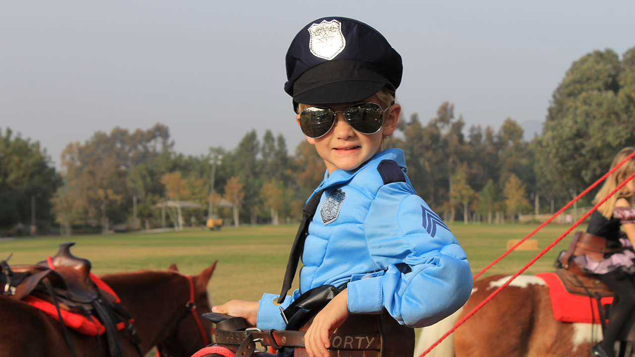 young boy in police costume