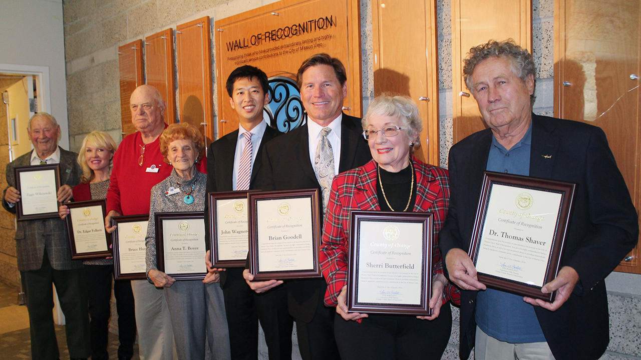 past wall of recognition winners with plaques