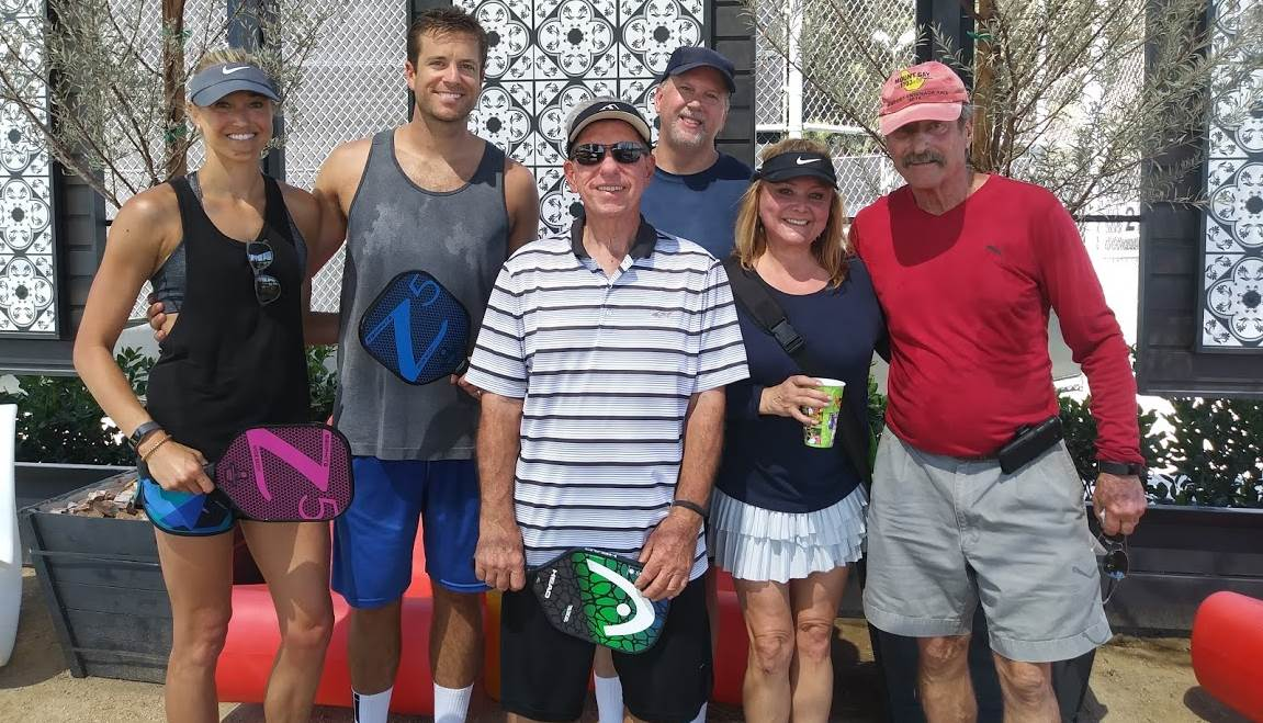pickleball players posing for photo
