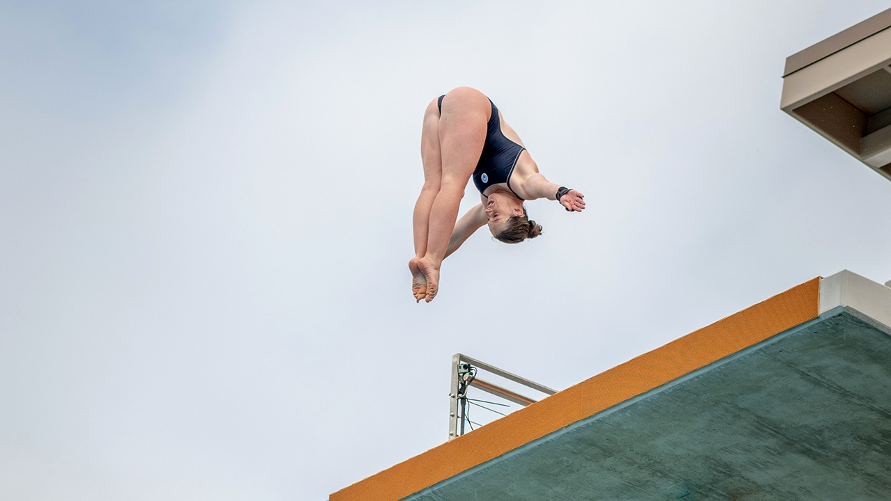 girl diving off high board