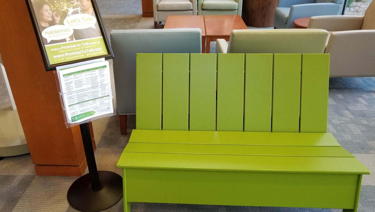 green bench inside community center