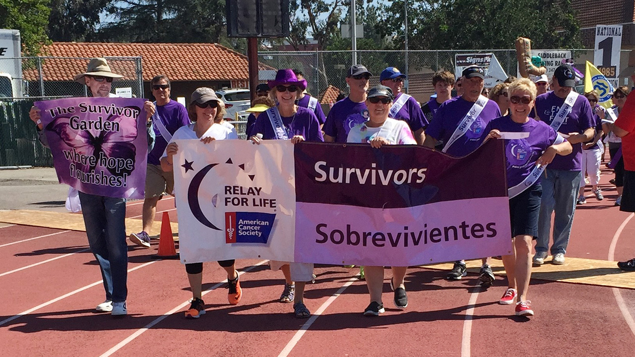 people walking at relay for life survivor walk