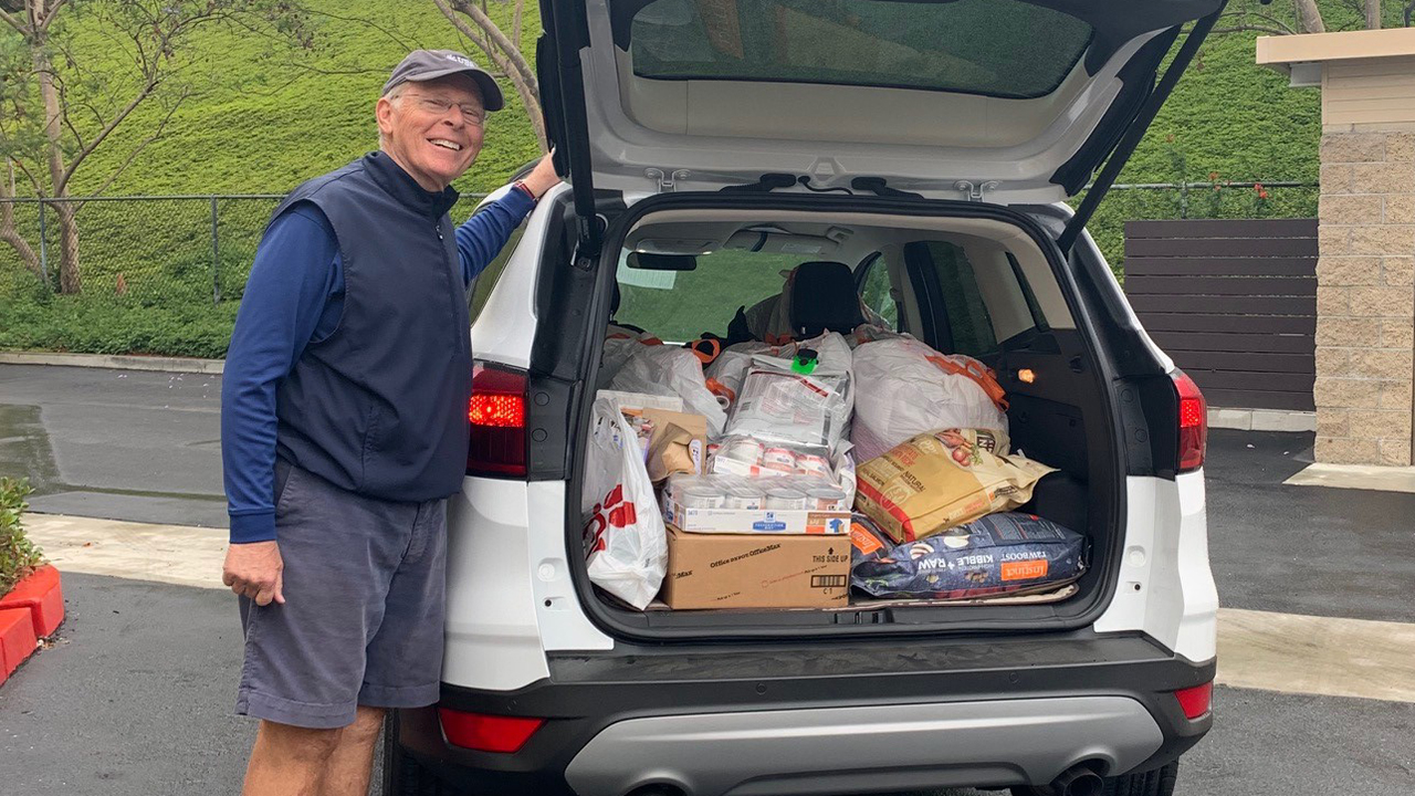 man with car full of pet donations