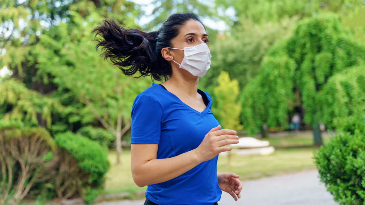 woman running with face mask on