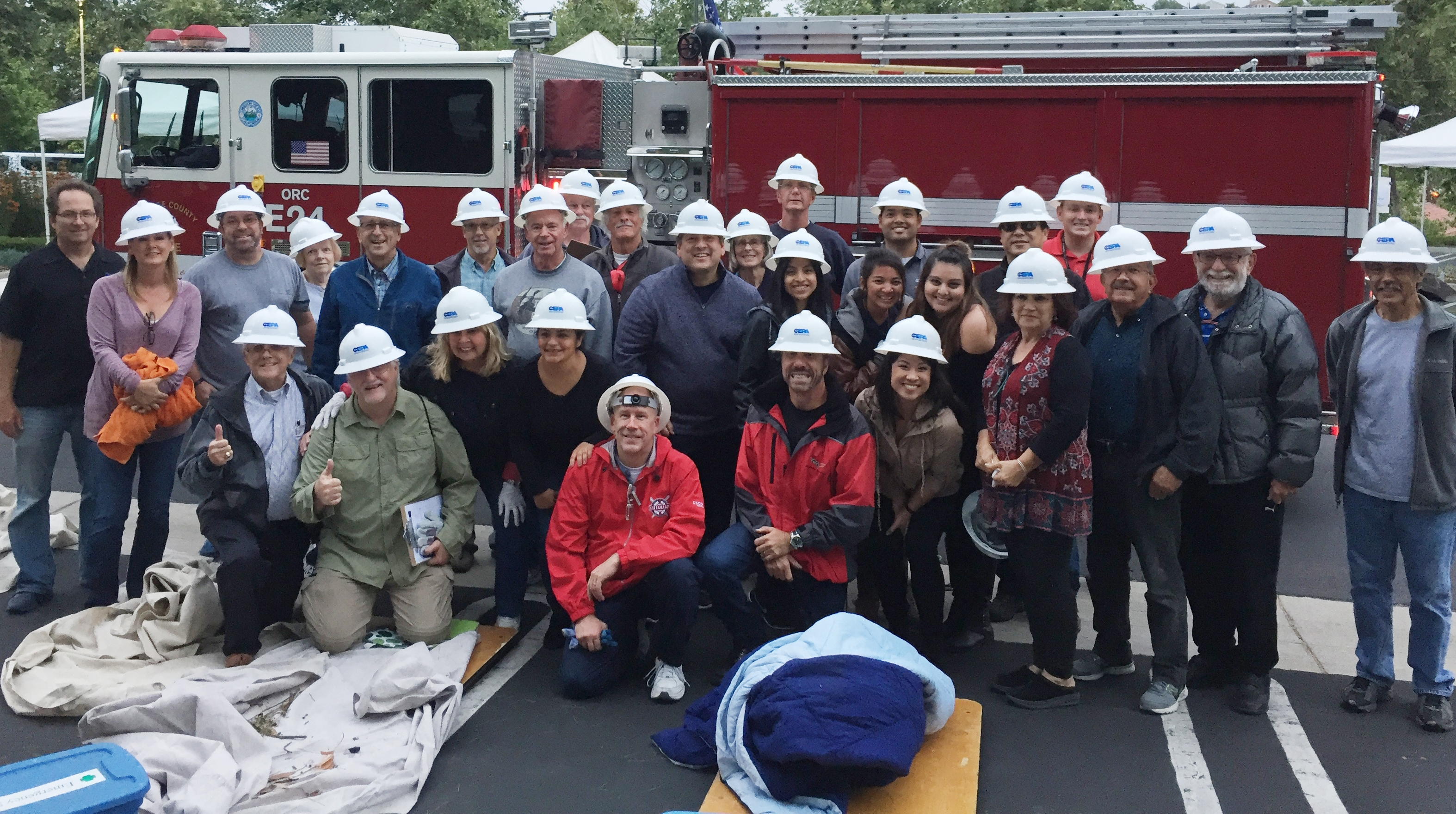 Community Emergency Preparedness Academy group posing in front of fire truck