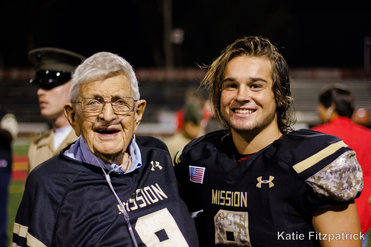 veteran with high school football player